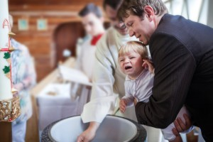 Little baby boy being baptized