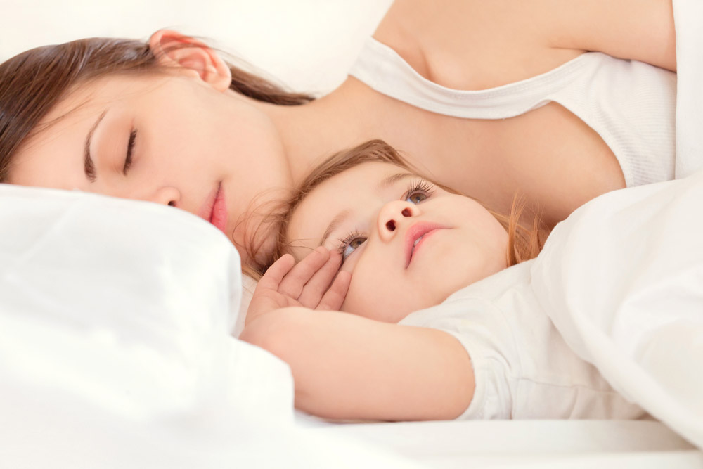 sleeping 11 month old with mother