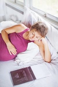 Pregnant woman reading a book