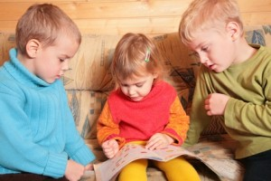 children read book on sofa in the wooden room 2