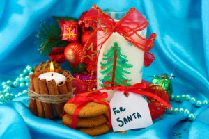 Cookies for Santa: Conceptual image of ginger cookies, milk and christmas decoration on blue background
