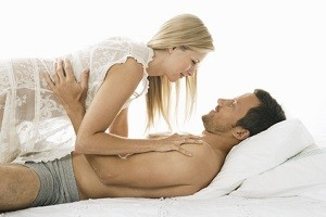 Young couple being affectionate in bed.