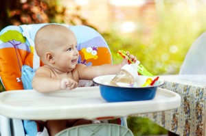 throwing food from the high chair