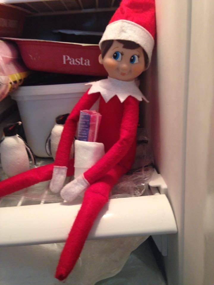 Easy Elf On The Shelf Ideas - Elf on THe Freezer Shelf
