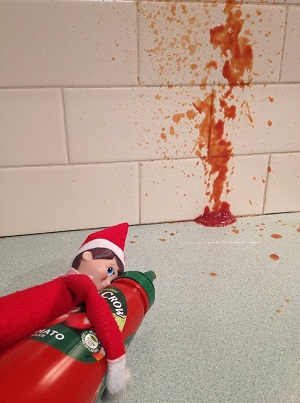 cheeky elf using the sauce