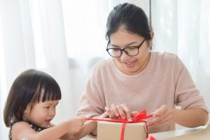 How to start an online store and work at home. Mother and toddler wrapping parcels