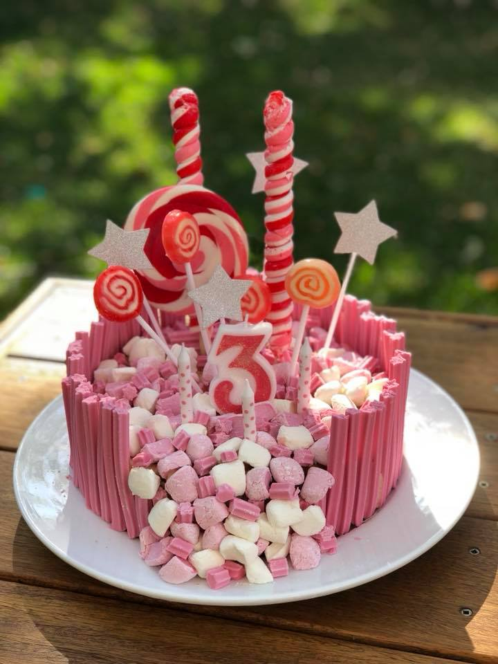 woolworths cakes pink musk sticks lollipops