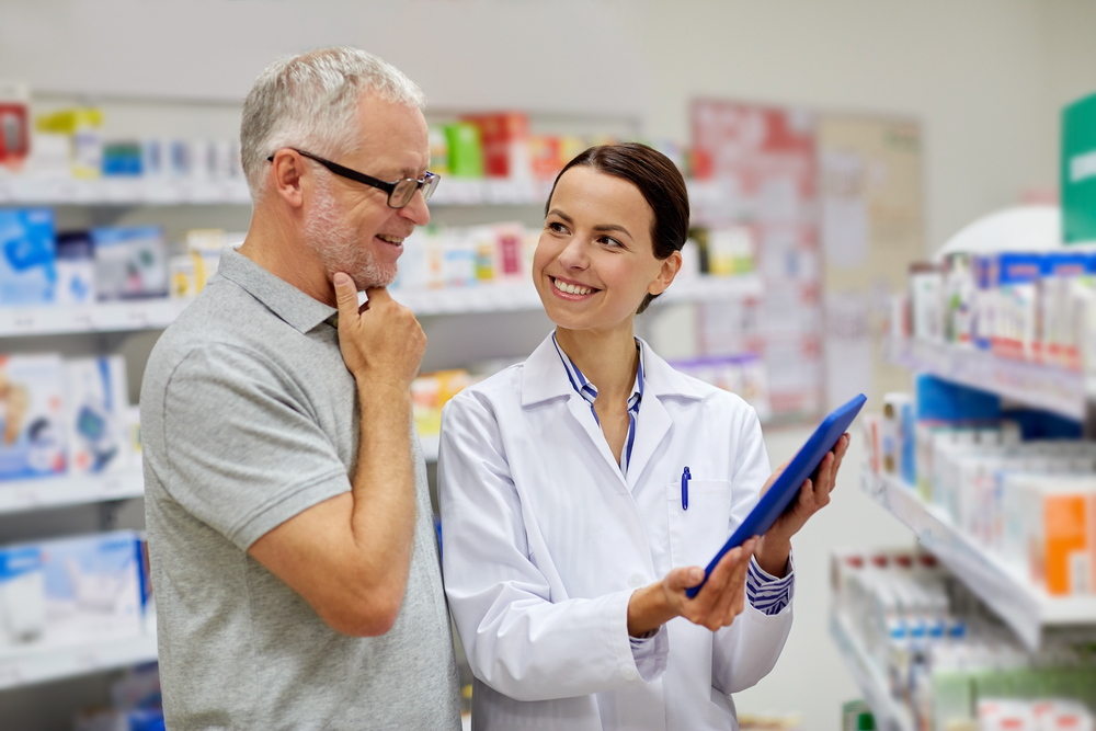 late night chemists brisbane pharmacist with customer